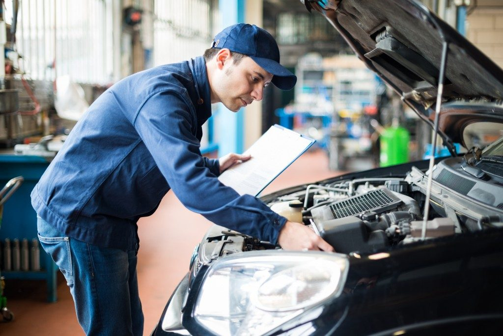 Auto mechanic working at garage