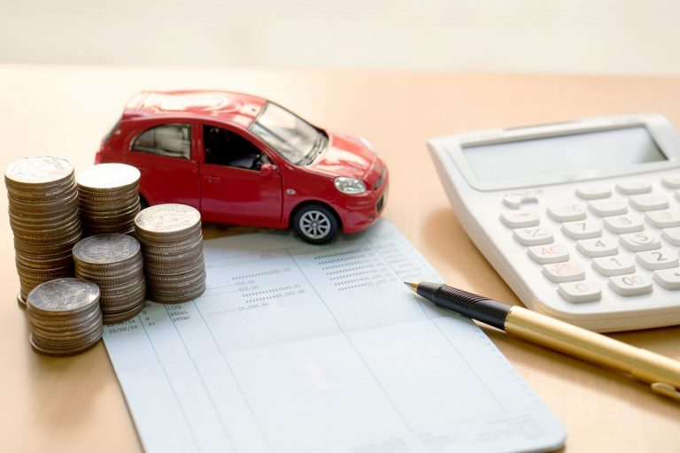 Money, small car model and calculator