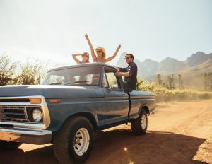 Friends on a pick up truck