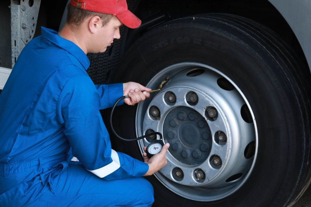 a man checking the tires