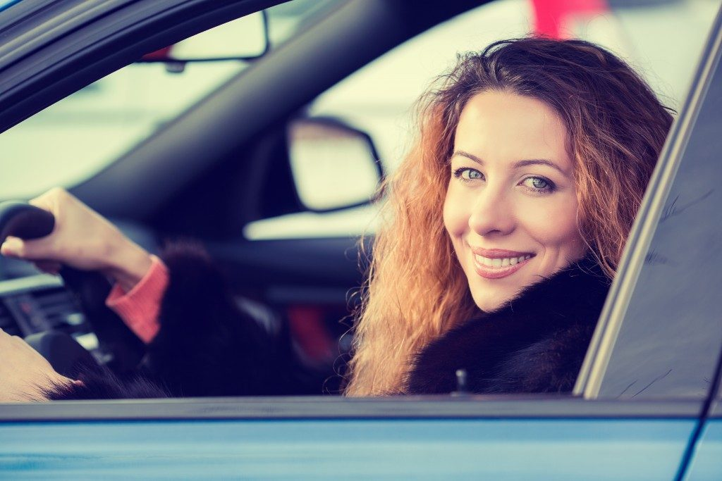 Woman about to test drive a car