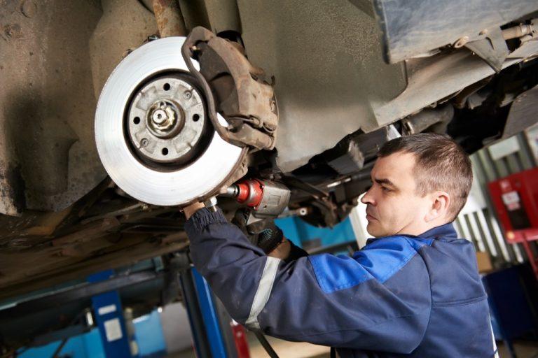Car mechanic examining a vehicle