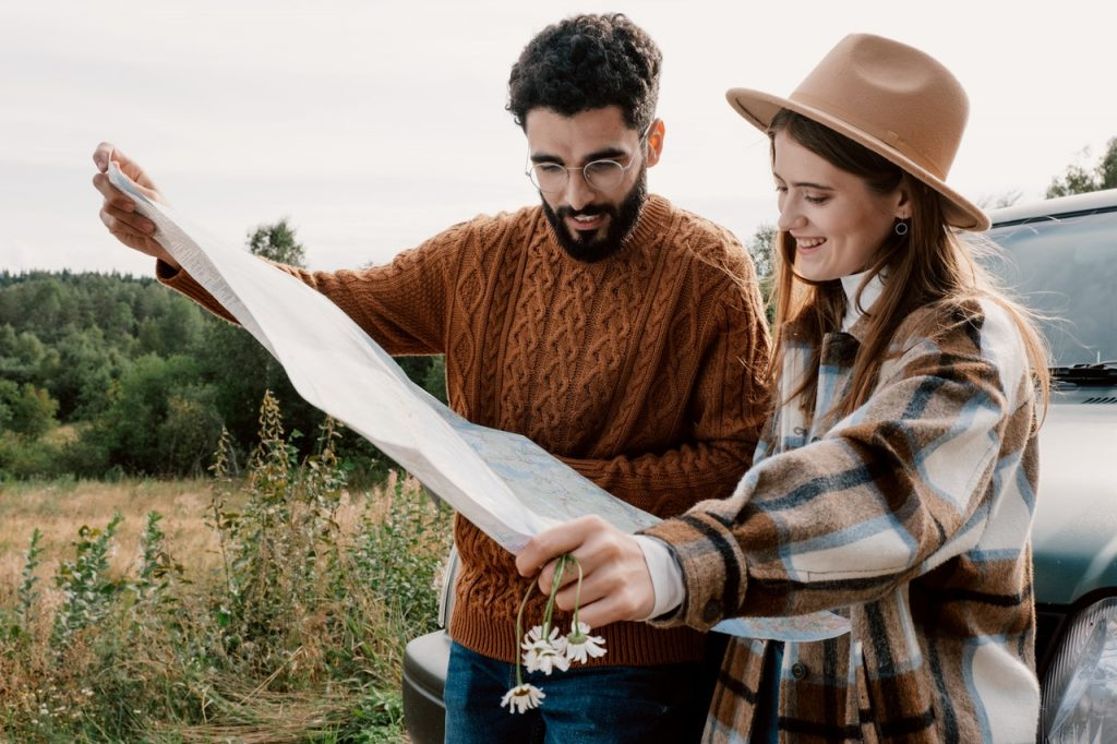 woman and man looking at a map